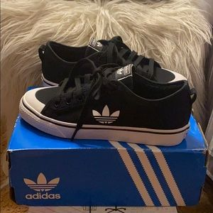 Adidas canvas sneakers for gals. New in box.